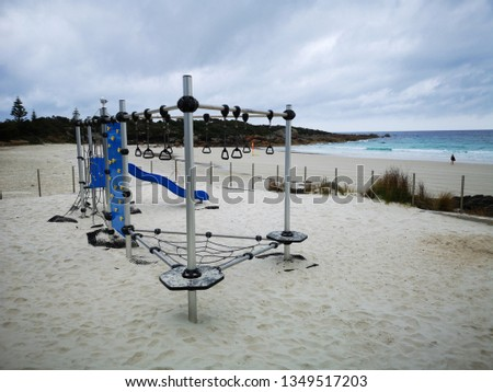 Children's safe play area with a climbing wall, slide and swings in Boat Harbour Beach on the north west coast of Tasmania.  #1349517203