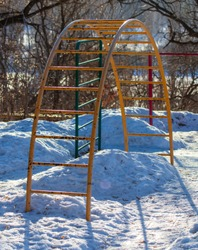 Children's sports ladder in the snow in the winter.