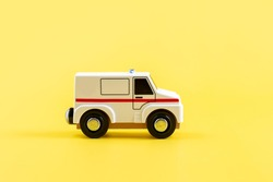 Children's toy, car on a yellow background. Ambulance. Concept. Isolate. Copy space. High quality photo