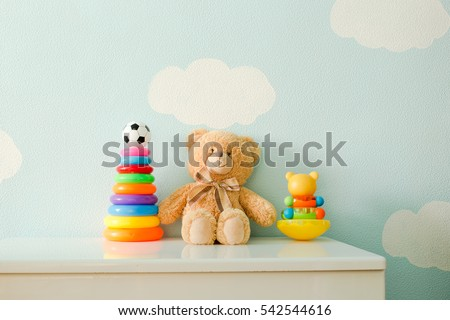 Stock Photo Children's toys against the wall of the sky clouds.