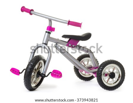Children's tricycle pink bicycle isolated on white background