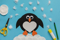 Children's winter craft Penguin made of paper and cotton wool. Children's art project. DIY concept. Easy craft for kids