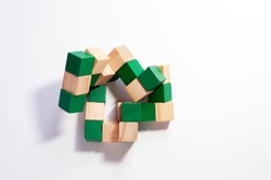 Children's wooden toy cubes on a white background