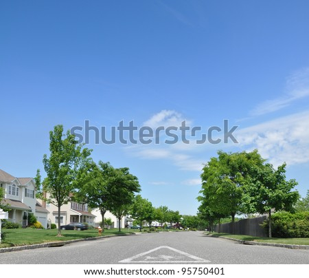 Children School Crossing Traffic Sign on street of Suburban Residential Neighborhood on Beautiful Blue Sky Day