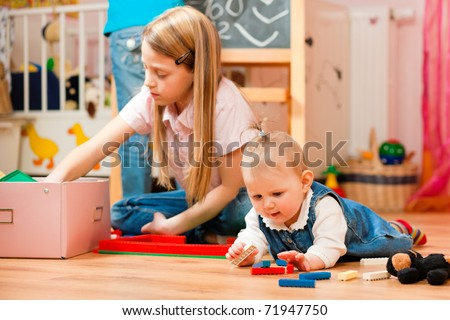 Children � sisters - playing at home; one child is still a baby