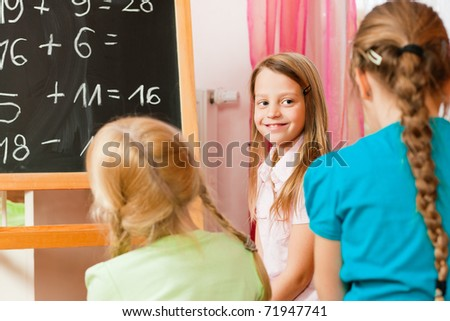 Children � sisters - playing school in their room