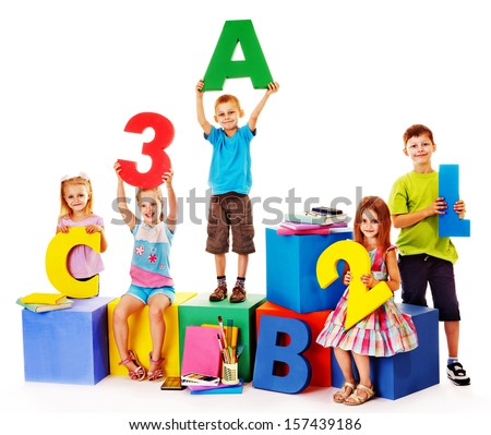 Children sitting at cube hand up