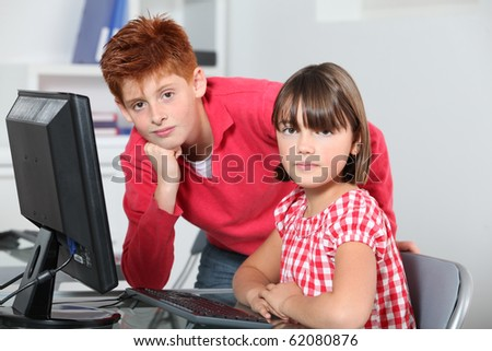 Children sitting in classroom in front of computer