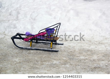 Children sled with nobody on the road
