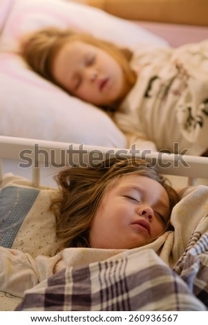 children sleeping girl in pajamas on the bed