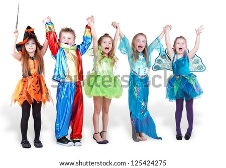 children stand holding hands and lifting them up and shout Stock photo ©