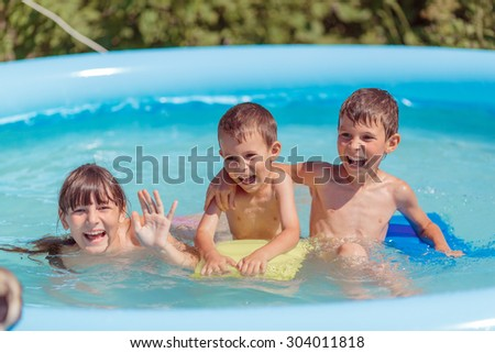 children swim in the pool and play