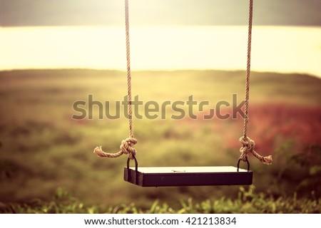 children swing in the park ...