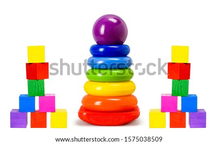 Children toys - pyramids and cubes isolated on white. Tiddler toys. Child toys isolated on white. Pyramids and cubes toys