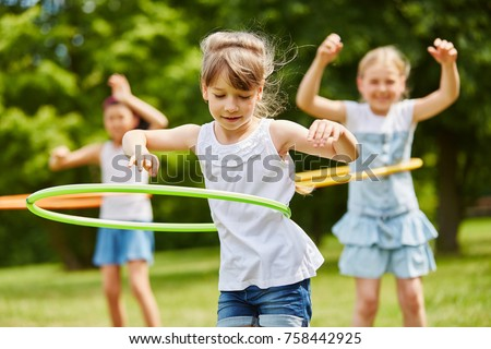 Children training their movement skills in the park