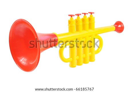 Children trumpet made of colored plastic against white background