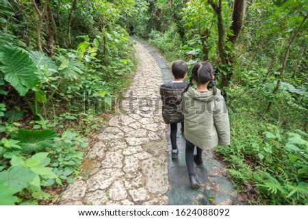Children walking at Okinawa's power spot Stock fotó ©