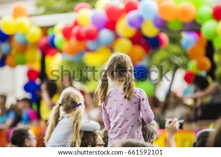 children watching colorful rainbow parade  #661592101