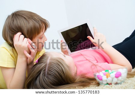 children watching tablet PC computer