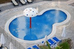Children Water Pool with Umbrella extreme closeup.