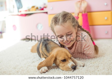 Children with a dog at home #1044757120