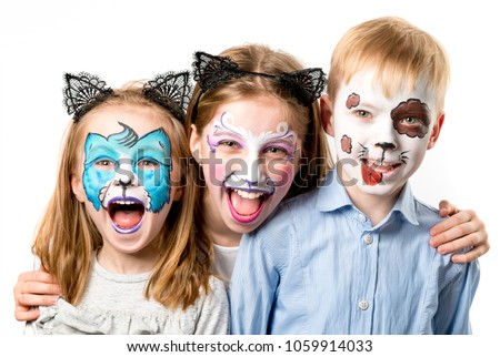 Children with animal face paintings isolated #1059914033