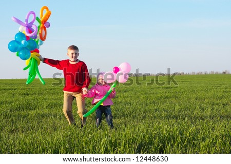 children with balloon outdoor - stock photo