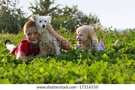children with dog - stock photo