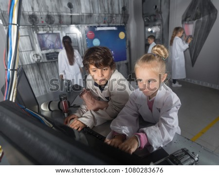 Children with enthusiasm unravel the secret in the bunker quest room #1080283676