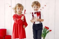 Children with flowers. Gentelman with tulip. Mother's day. Valentines day.