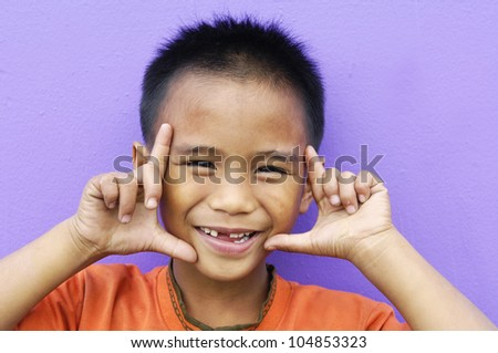 children with funny expression gesture open hand fingers-close up