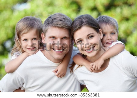 Children with parents in the park - stock photo