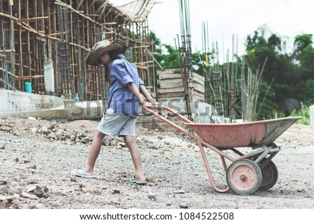Children working at construction site for world day against children labour concept: