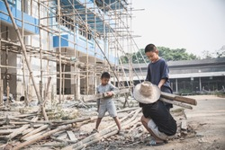 Children working on construction sites,  Poor children, poverty, Child labor, human trafficking, World Day Against Child Labour concept.