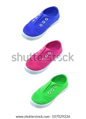Childrens canvas shoes isolated against a white background - stock photo