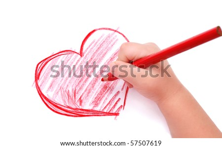 Childrens hand with pencil draws the heartl, isolated