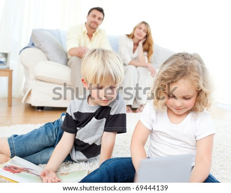 Childrens reading books in the living rooms - stock photo