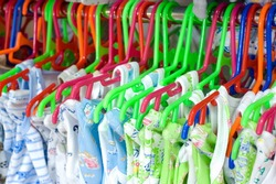 childrens underclothes on hangers at a store