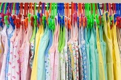 childrens undershirts on clothes hangers at a store
