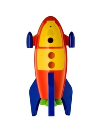 childs toy rocket on white background with reflection