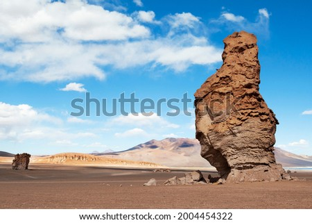 Chile, Atacama Desert, Los Flamencos National Reserve. Eroded volcanic structures called the Pacana Guardians dot the landscape. Foto stock ©