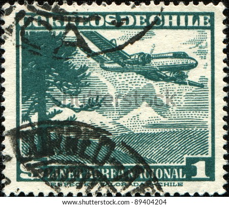 CHILE - CIRCA 1950: A stamp printed in Chile shows airplane ower Araucanian pine tree, circa 1950