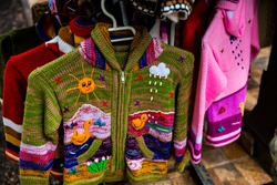 Chile, Punta Arenas. Colorful Chilean children's woven sweaters.