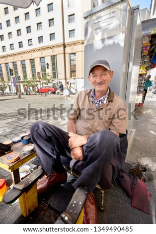 Chilean Elderly Man Shoe Shine Worker. News of Aging and Social Policies Distribution in Chile/South America. Santiago, Chile, March, 2019. #1349490485
