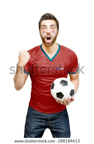 Chilean fan holding a soccer ball celebrates on white background - Shutterstock ID 288184613