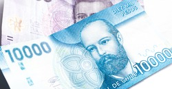 Chilean Peso ( CLP), currency of Chile. Banknotes of ten thousand pesos and 2 thousand pesos in close-up.