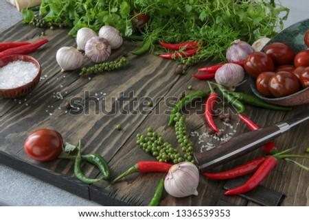 chili, allspice, garlic, parsley, coriander, dill, tomatoes on the table #1336539353