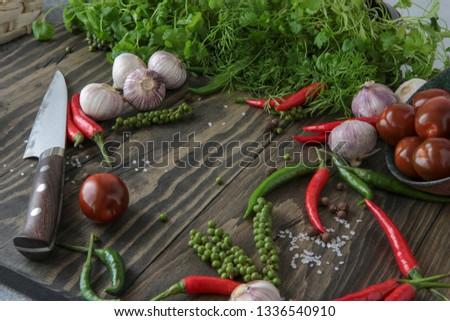 chili, allspice, garlic, parsley, coriander, dill, tomatoes on the table #1336540910