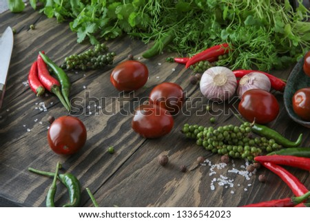 chili, allspice, garlic, parsley, coriander, dill, tomatoes on the table #1336542023
