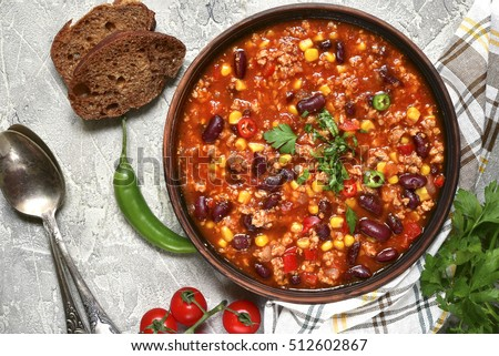 Shutterstock Chili con carne in a clay bowl on a concrete or stone rustic background- traditional dish of mexican cuisine.Top view.